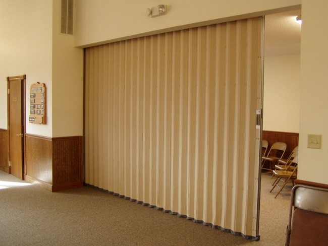 Commercial accordion folding doors for security and more for Retractable walls commercial