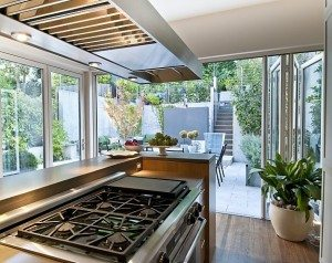 Incorporating glass accordion folding doors is a great way to increase natural sunlight in your home