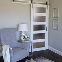 The Modern Barn Door has acrylic panels that let light into the room but still block visibility.